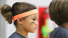 Girl in FITGirl Inc's EmpowerU lessons wearing headband